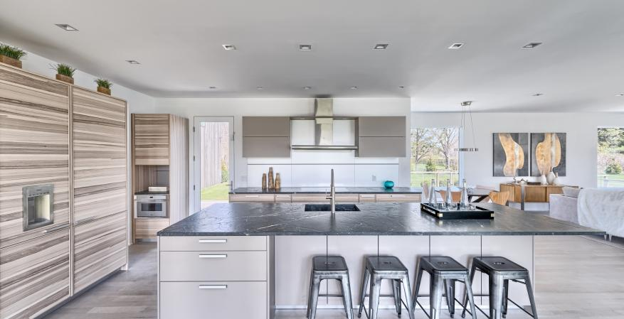 The pair of homes in the Seaview Development in East Hampton, N.Y., boast a similar modern-farmhouse vernacular, but subtle differentiations from the exterior materials to the sleek kitchen cabinets set each residence uniquely apart.