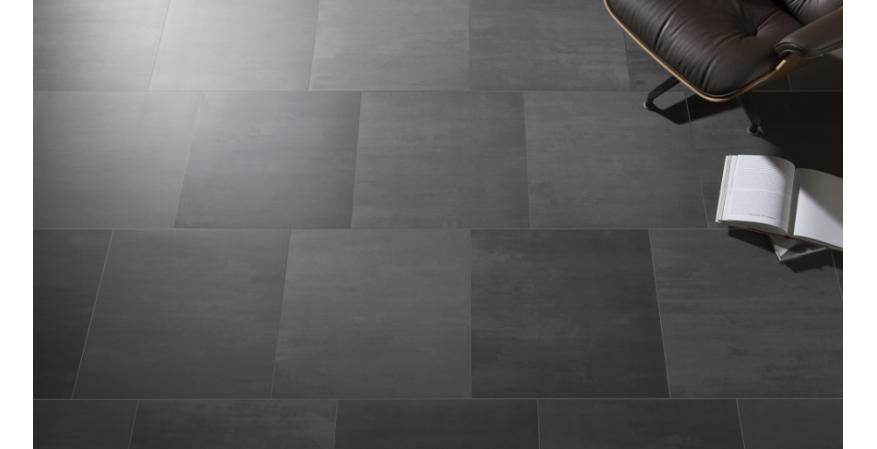 MOSA Black Absolute tiles  Mosa Tiles were used on the floor of reACT's core and courtyard modules. The tile is suitable for indoor and outdoor applications, which allow for a clean transition between two prominent spaces in the house.