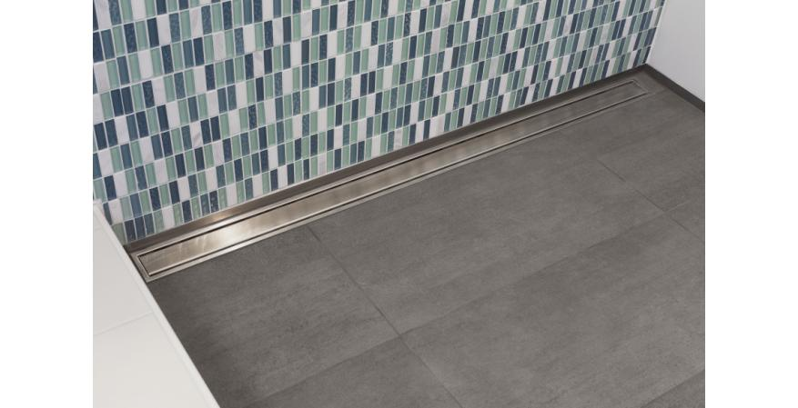 Bathroom idea - A linear or trench drain creates a cleaner look and promotes universal design