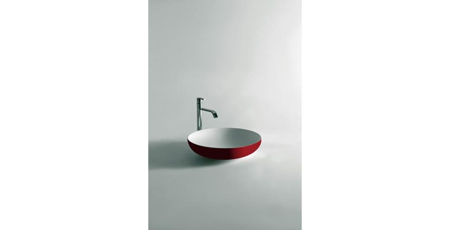 Flumood, a new collection of top-mount solid surfacing sink in red