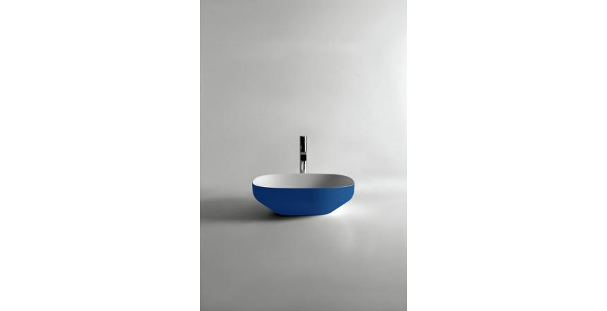 Flumood, a new collection of top-mount solid surfacing sink in blue