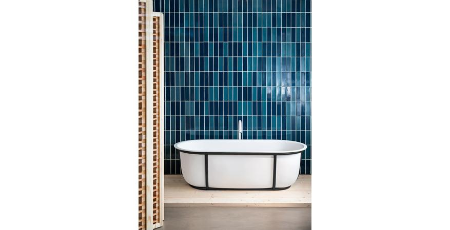 Designed by Patricia Urquiola for Agape, Cuna is a compact solid surface freestanding tub with a tubular steel frame. Available in multiple finish combinations, it has a 58-gallon capacity and measures approximately 65 inches by 20½ inches by 31 inches
