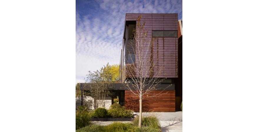 This single-family home in Chicago's Lincoln Park neighborhood features copper cladding that was installed as a rainscreen, which allows the wall assembly to dry out and avoid premature mold.