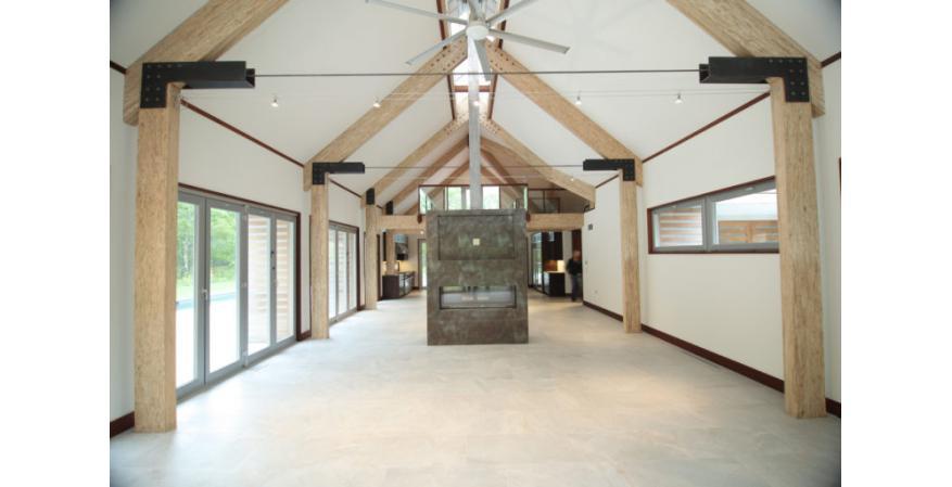 Exposed engineered wood beams inside barn house interior