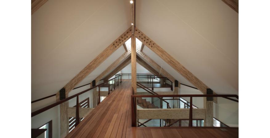 exposed engineered wood beams ceiling barn house interior