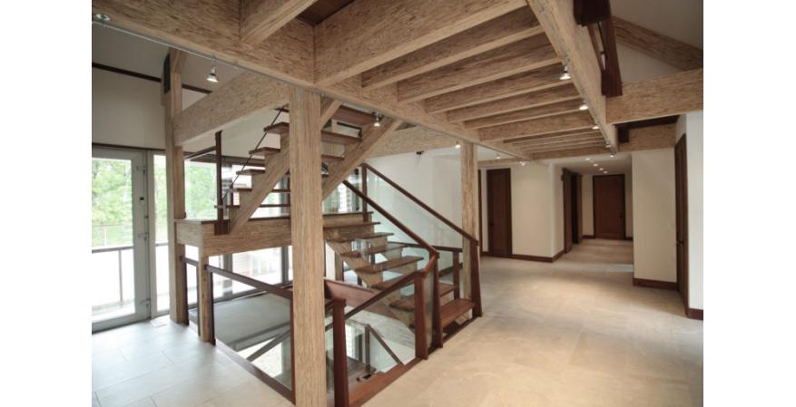 exposed engineered beams staircase barn house interior