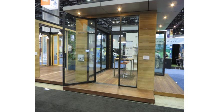 The manufacturer's new Pivot Door System features a narrow stile and rail profile for more glass, light, and consistent-width panels for balance and symmetry. Available with direct-set or panel glazed sidelites and transom and a flush threshold, the door comes with high-performance hardware and low-E glass. It comes in a range of materials, such as aluminum and aluminum-clad wood