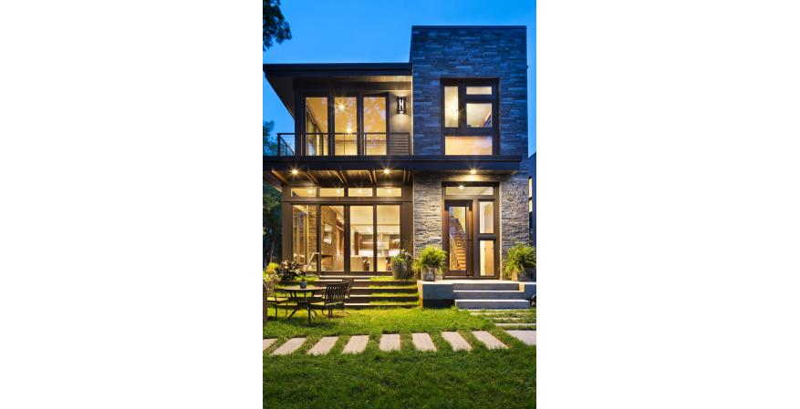 This modern residence offers a unique combination of privacy from adjacent homes. The home's contemporary exterior features natural stone, corten steel, wood, and glass, all in perfect alignment with the site. The design goal was to take advantage of the views of Lake Calhoun by providing the homeowners with expansive walls of Integrity Wood-Ultrex Windows. With a small footprint and open design, stunning views are present in every room, making the stylish windows a huge focal point of the home.