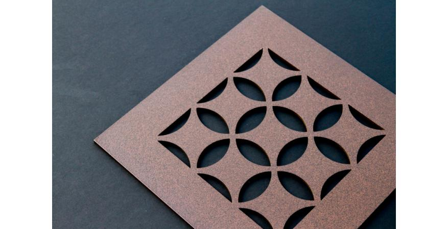 A brown grille from AJK Design Studio with a Moroccan pattern for AC registers.