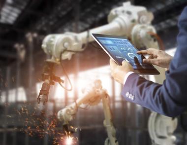 Engineer controls construction robot