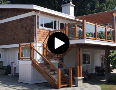 Jesse de Geest, founder of the Samurai Carpenter, renovated his old home with a new roof, cladding, and a second-story patio with a wooden-framed glass railing system.