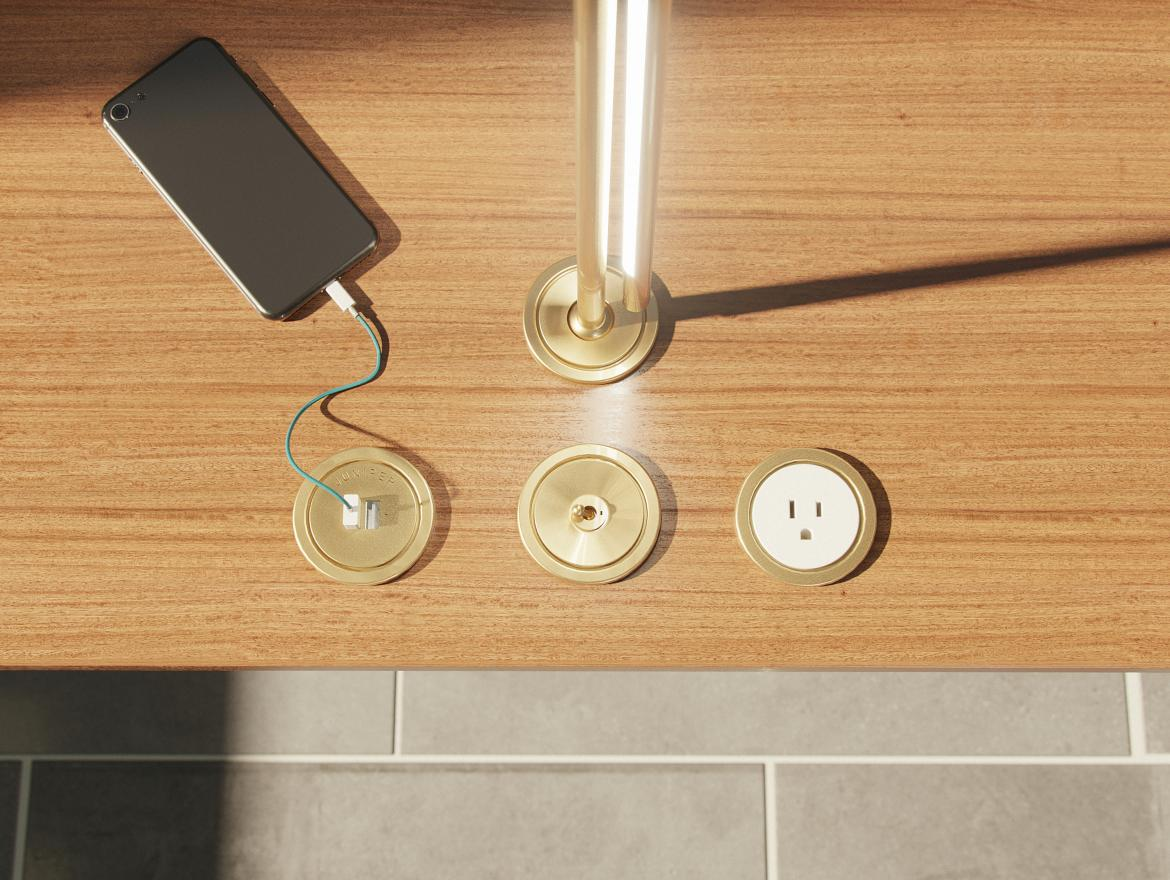 Lighting manufacturer Juniper Design Studio has introduced a line of brass surface-mounted electrical accessories that draws inspiration from the dials and switches of mid-century NASA mission control rooms.