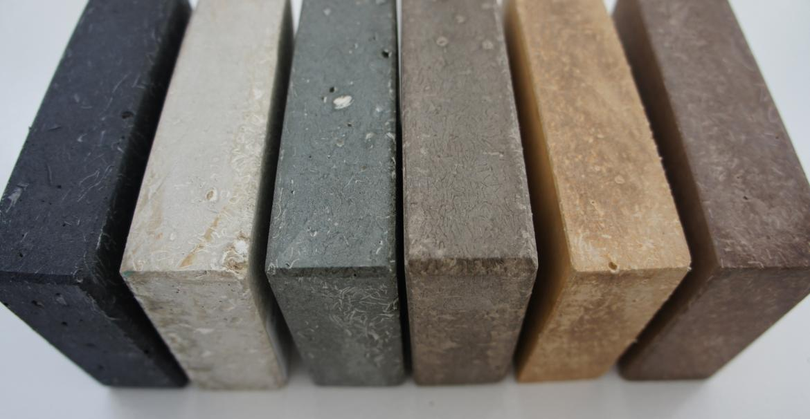 "The manufacturer's product is a fibrous-cement material comprised of recycled paper, recycled glass, and low-carbon cement. It is hand-cast into ""slabs"" as an alternative to natural or quarried stone and has the appearance of soapstone or limestone."