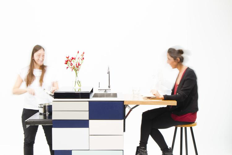 Ana Arana has developed a new compact and transportable kitchen module that includes everything someone living in a small space would need, including sink, fridge, induction cooktop, storage, and dining table.