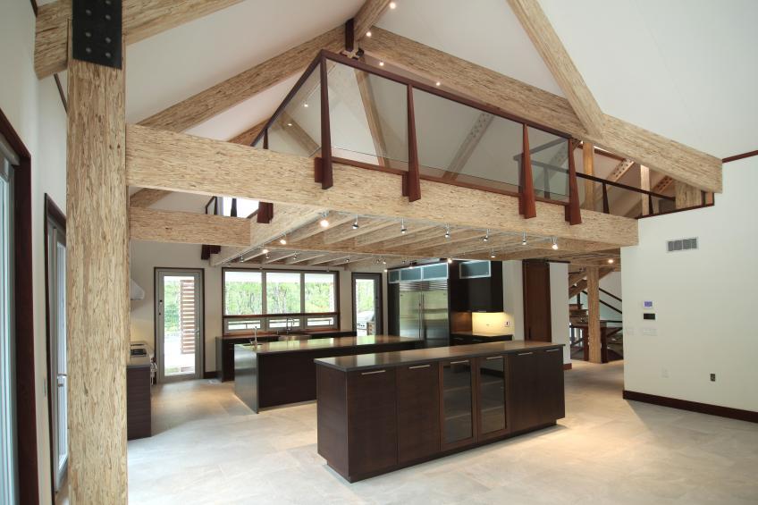 Exposed Engineered Wood Completes Modern Barn House Interior