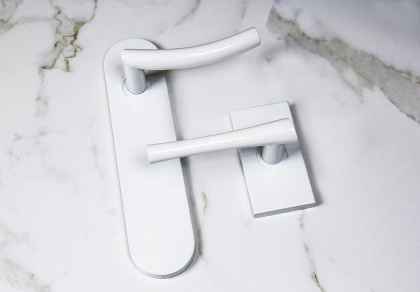 Inox CeraMax Door Hardware with white Marble background