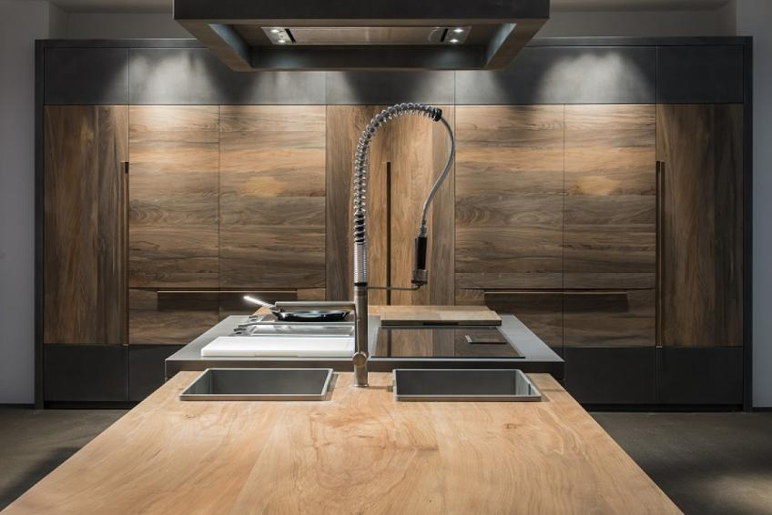 Seeking a stand-out material for its new line of products, Italian cabinet brand Toncelli turned to an 800-year-old Serbian beechwood whose well-seasoned personality will resist water absorption and abrasion, the company says.  The wood is being used for the company's Essence line. While the fossil beechwood makes up the majority of the kitchen, titanium steel is used for the cooking surface.