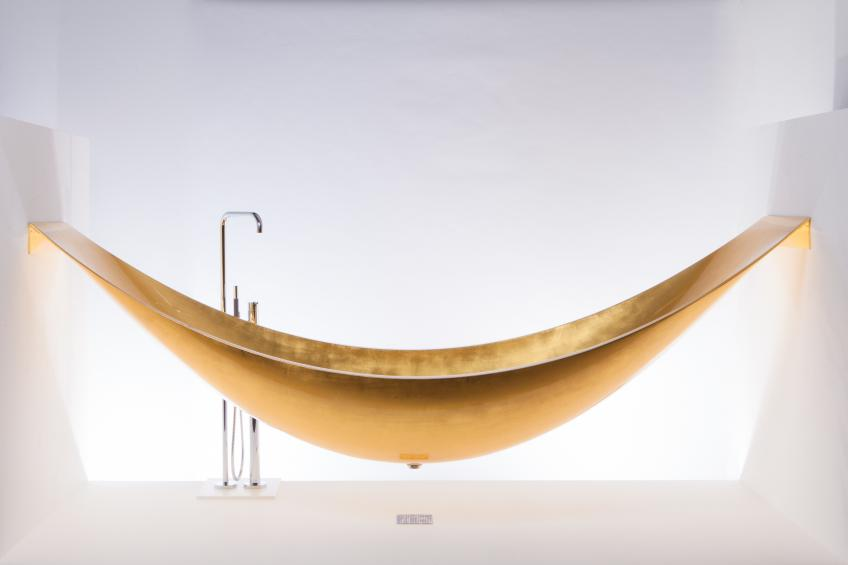 Though striking as a freestanding model, Splinter Works' Vessel is most compelling as a suspended hammock-style installation. Supported by stainless steel brackets at both ends, the tub comprises layers of carbon fiber and an insulating foam core and extends about 8 feet to 9 feet in length; custom sizes are available.