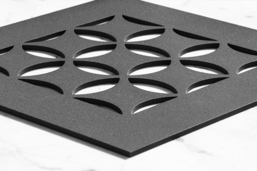 An AJK Design Studio Black Grille With A Moroccan Pattern For AC Registers.
