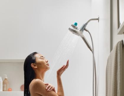 Moen Aromatherapy Handshower with INLY Technology Woman Bathing