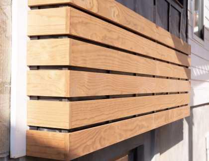 A decorative sustainable wood product installed over Benjamin Obdyke's Invisiwrap UV and Batten UV rainscreen system.