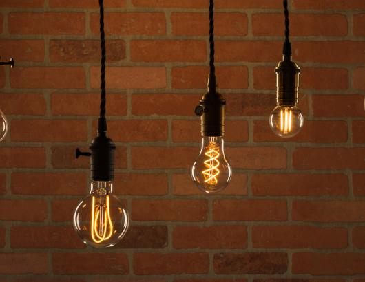 Feit Electric's LED Original Vintage Glass light bulbs shown in pendant lights