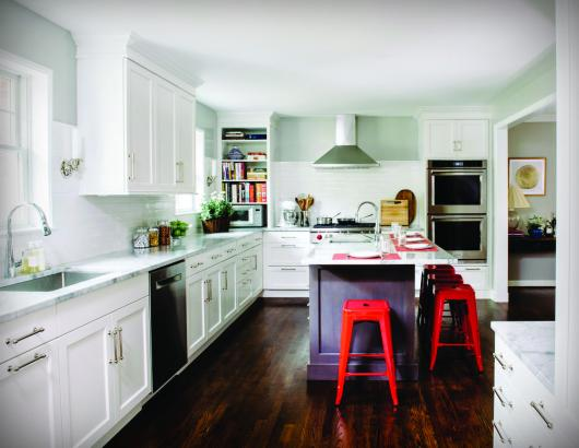 Presented with a dark, 157-square-foot kitchen, designer Nadia Subaran eliminated doors and added creative storage to give the space a new lease on life.