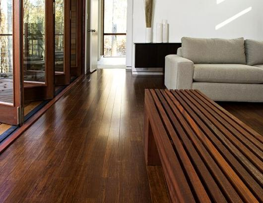 """Homeowners who select wood flooring at Uptown Floors in Bonita Springs, Fla., are looking for planks with """"character,"""" says owner Ken Fisher. His top sellers: planks measuring 5 to 10 inches wide, with a mildly distressed finish and a dark brown stain. The preferences are showing at showrooms across the country."""