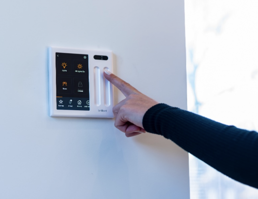 SYMBI installed three Brilliant Control Panels throughout their homes