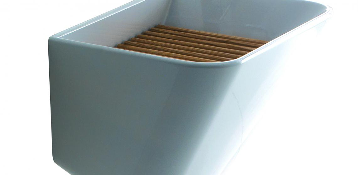 Meg11 is a modern take on the utility sink. Designed by Antonio Pascale, the wall-mounted washbasin is made from a single block of ceramic and features clean, fluid lines. It measures 25½ inches wide and comes with an ash wood grate.