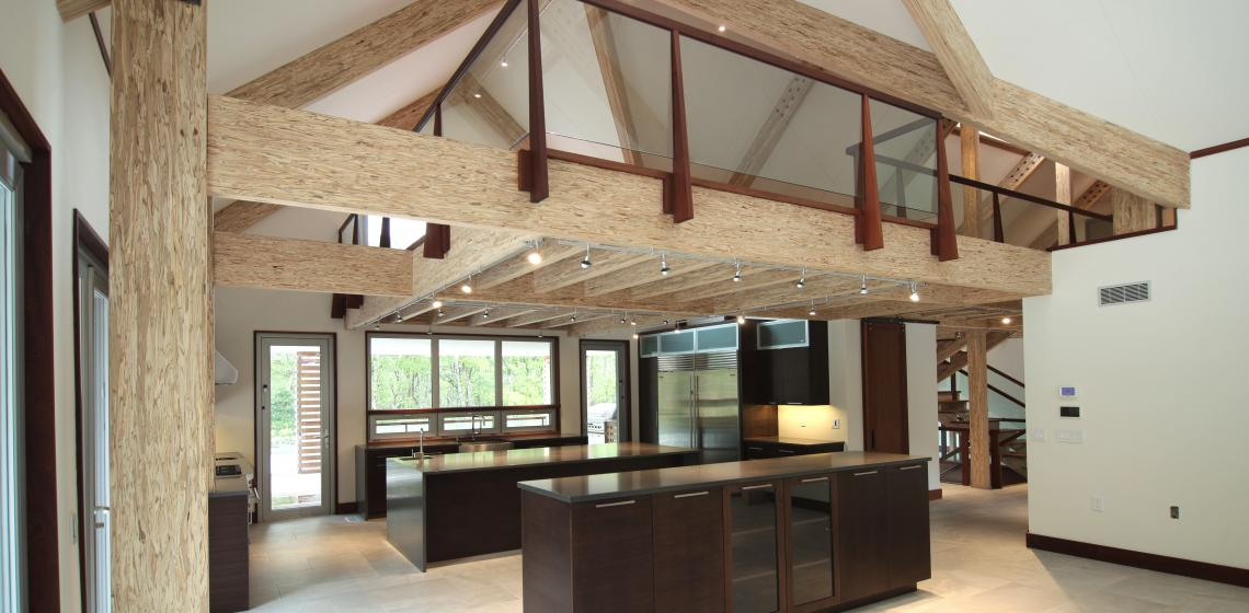 Exposed Engineered wood beams barn house interior