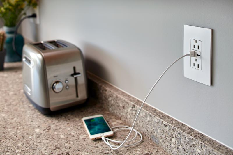 Legrand Ultra Fast USB Outlet toaster phone plugged in