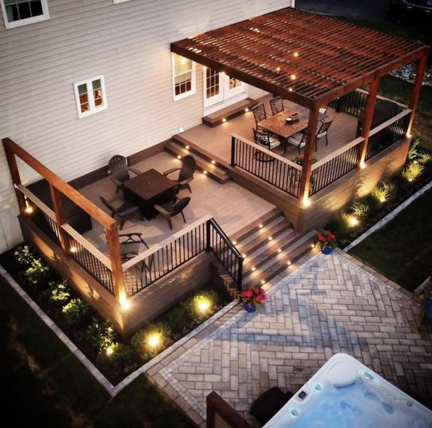 Wood composite deck at dusk with lighting